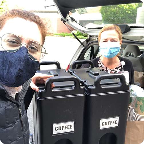 Masked restaurant and healthcare workers delivering coffee