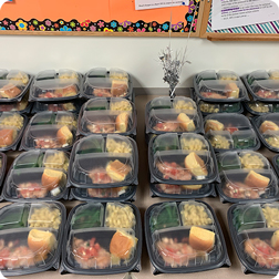 A table full of boxed lunches from Premier Catering