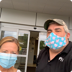 A worker from MoMo BBQ taking a selfie with a worker from the hospital